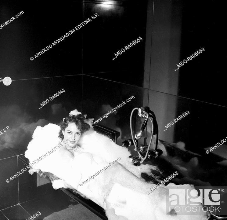 Greek-born Italian Yvonne Sanson relaxing in the tub in the
