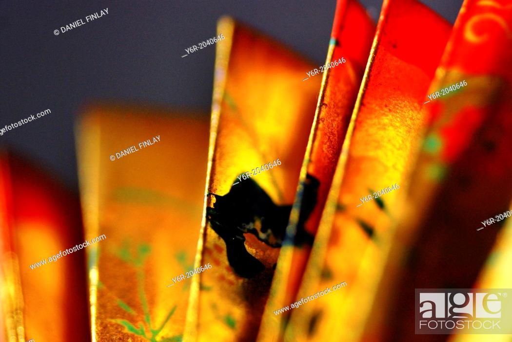 Stock Photo: Chinese / oriental fan in evening light.
