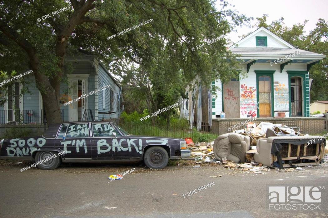 Stock Photo: 'I'm Back!' is painted upon a car outside some homes in the Lower Ninth Ward, New Orleans `.