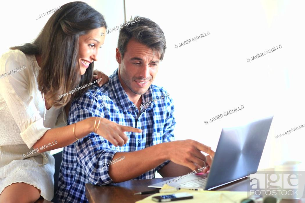 Stock Photo: Couple working with laptop.