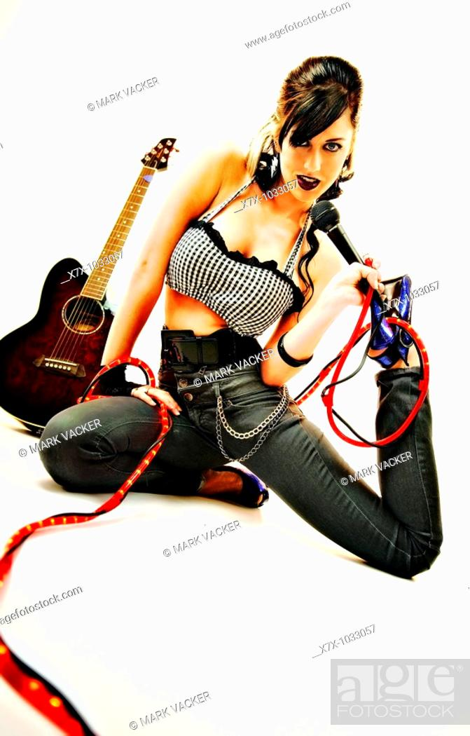 Stock Photo: Beautiful Eastern European brunette woman lives out her fantasy to be a rock queen.