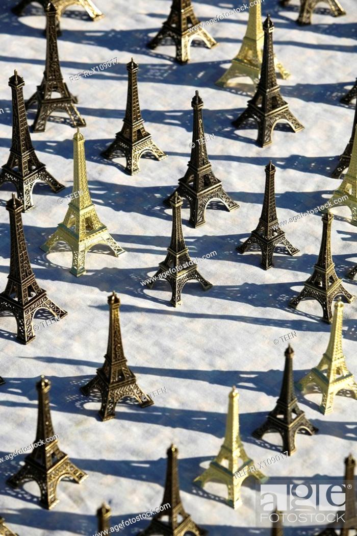 Stock Photo: Display of miniature Eiffel tower Souvenirs, Paris, France.