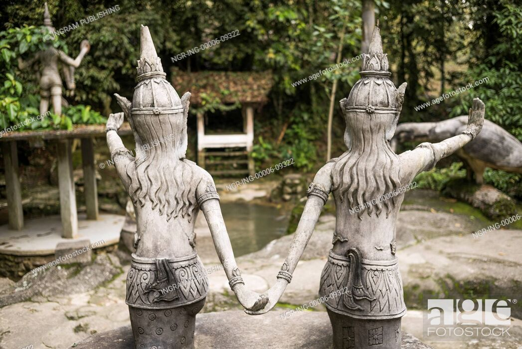 Stock Photo: Rear view of two statues in Heaven's Garden, Koh Samui, Surat Thani Province, Thailand.
