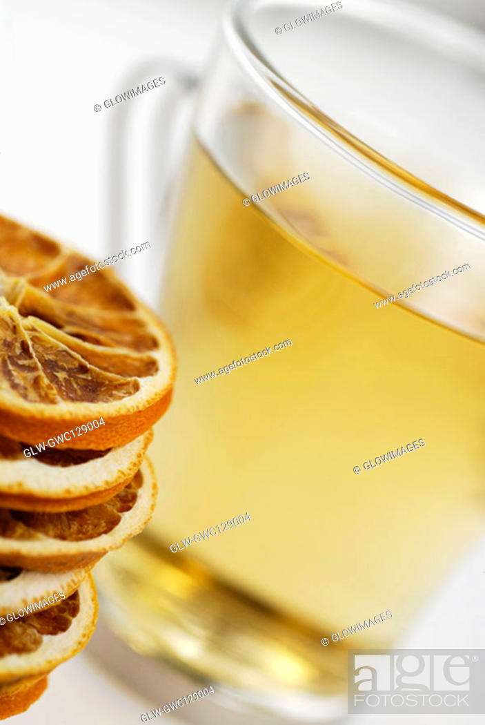 Stock Photo: Close-up of lemon slices and a cup of herbal tea.