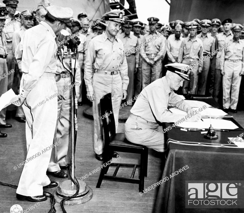 Fleet Admiral Chester Nimitz Signs For The United States During Japanese Surrender Ceremony Aboard USS Missouri In Tokyo Bay
