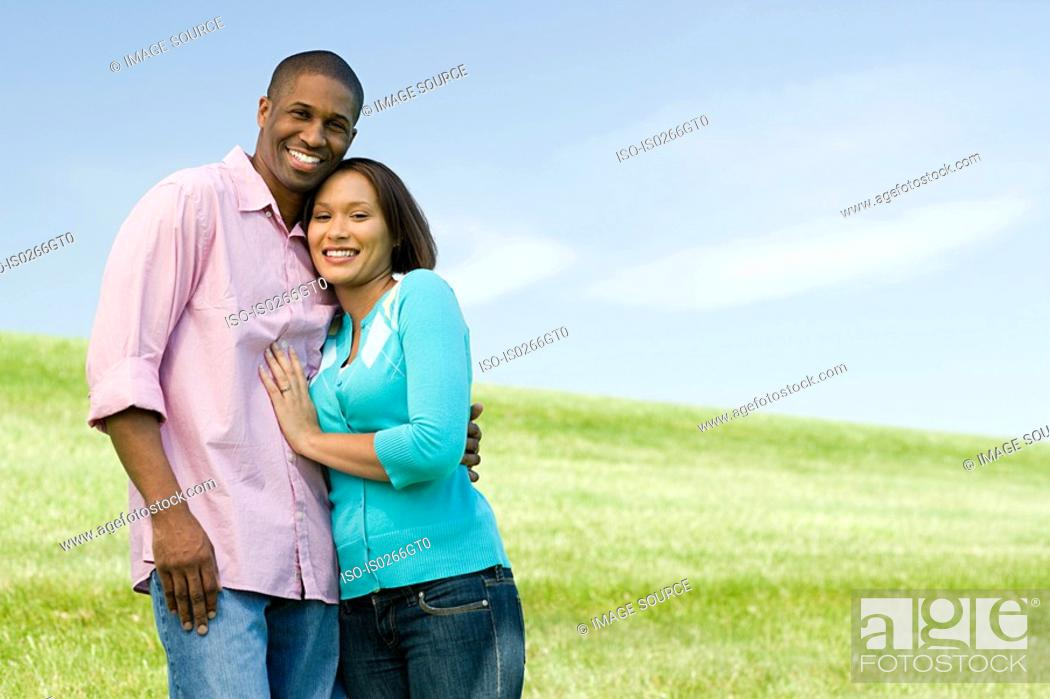 Stock Photo: Couple in a field.
