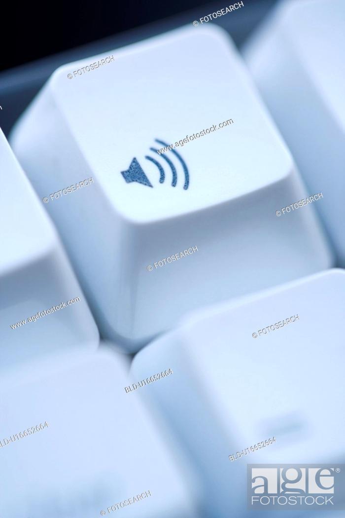 Stock Photo: Close up of volume key on computer keyboard.