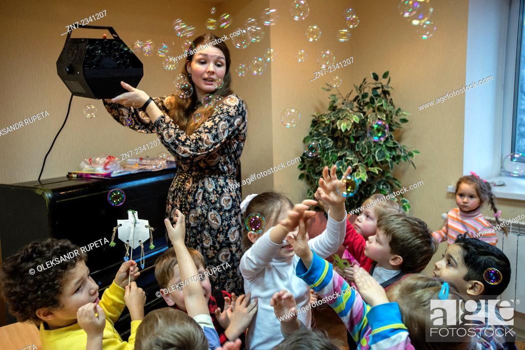 Stock Photo: Jewish children celebrate Hanukkah in Kiev Jewish Messianic Congregation Center, Kiev, Ukraine.
