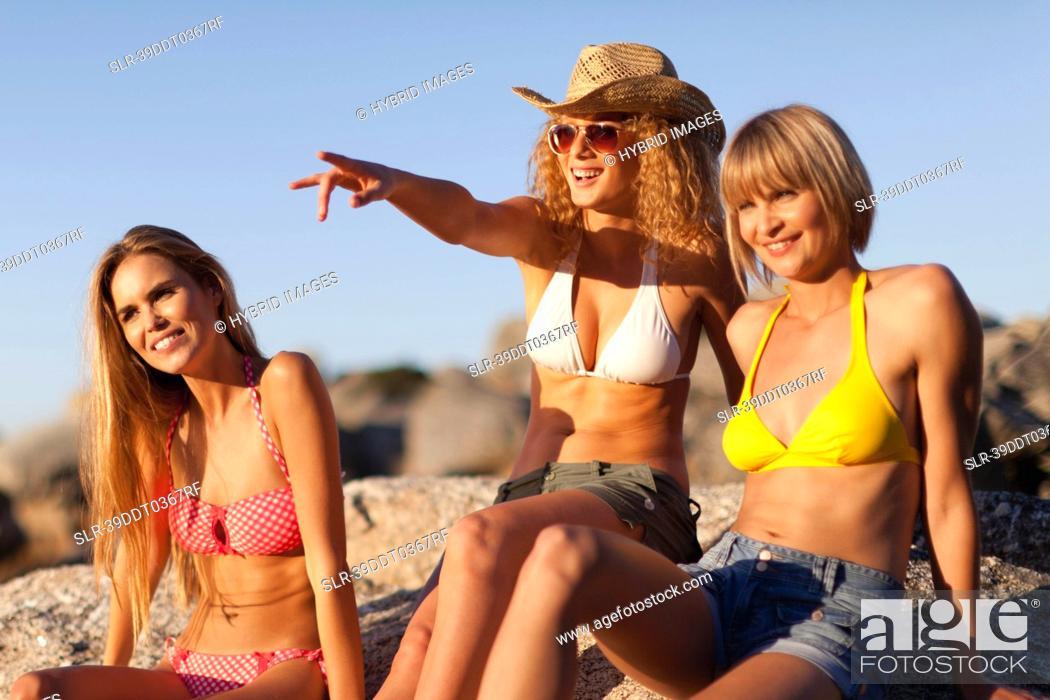 Stock Photo: Women admiring beach together.