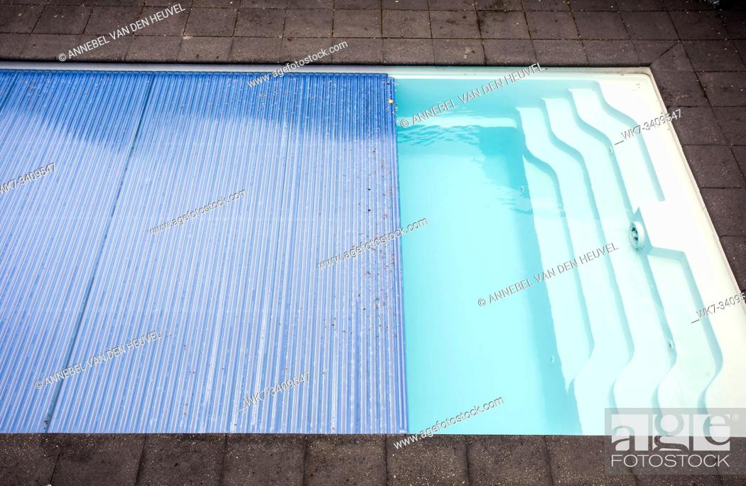 Stock Photo: Swimming pool cover detail for protection and heat the water, pool roller-shutter covers close-up.