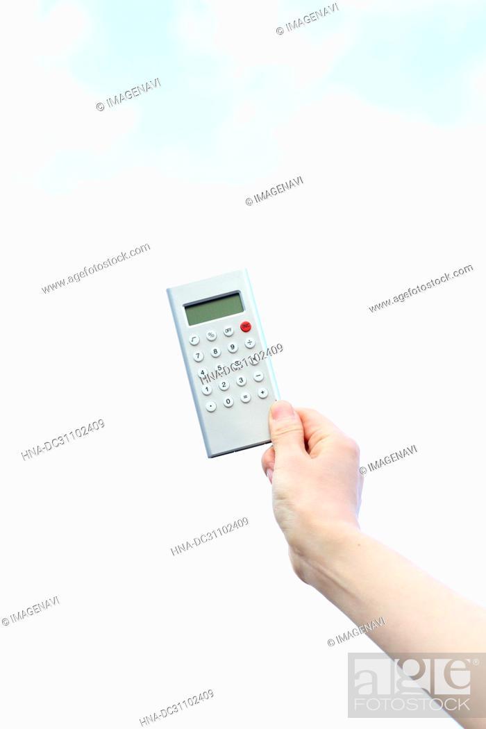 Stock Photo: Woman Hand Holding Calculator.