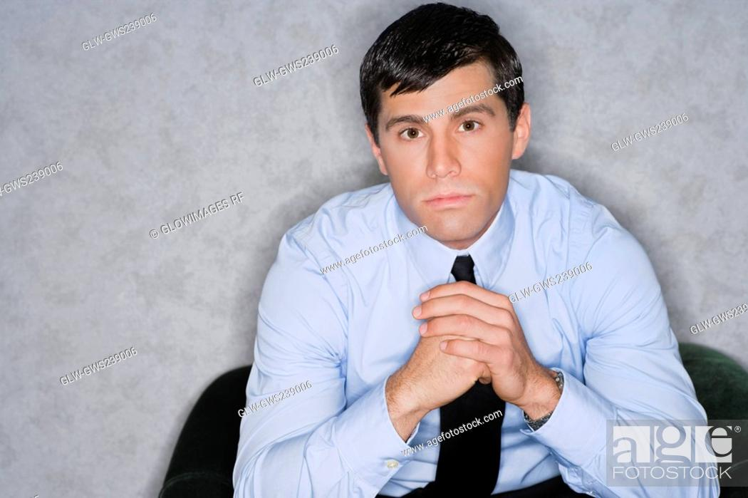 Stock Photo: Portrait of a businessman thinking.