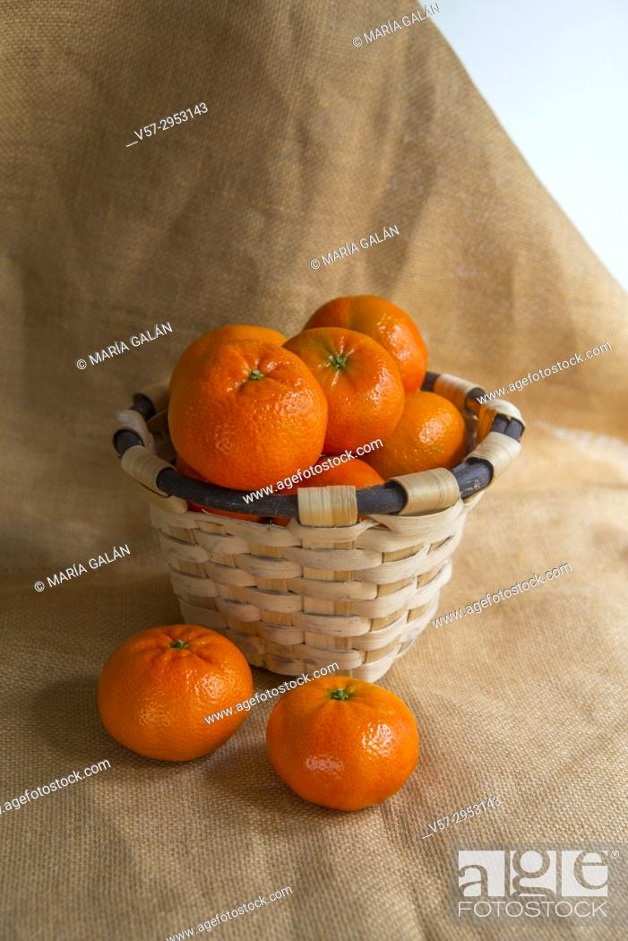 Stock Photo: Basket full of mandarines. Still life.