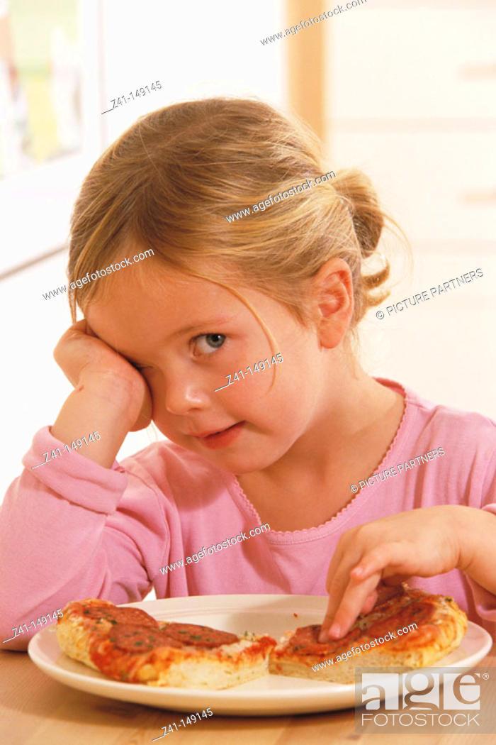 Stock Photo: Girl eating pizza.