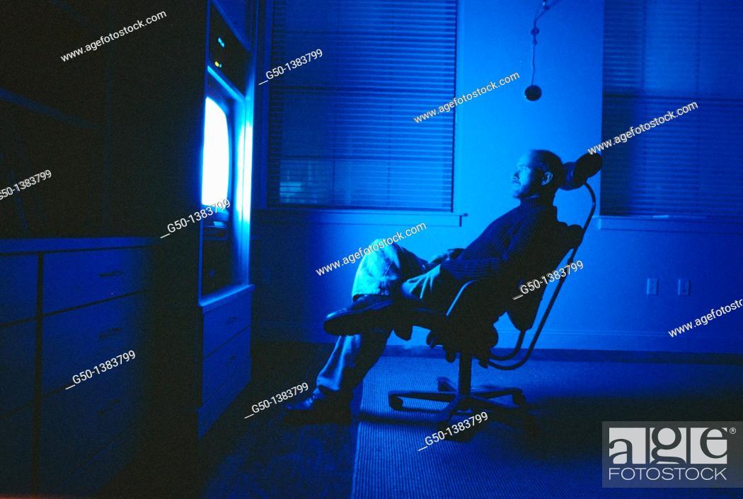 Stock Photo: man watching television.