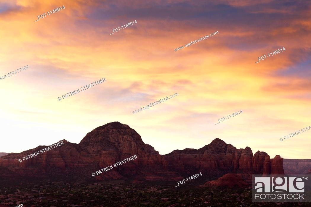 Stock Photo: View of rock formations in a desert at sunset, Sedona, Arizona, USA.