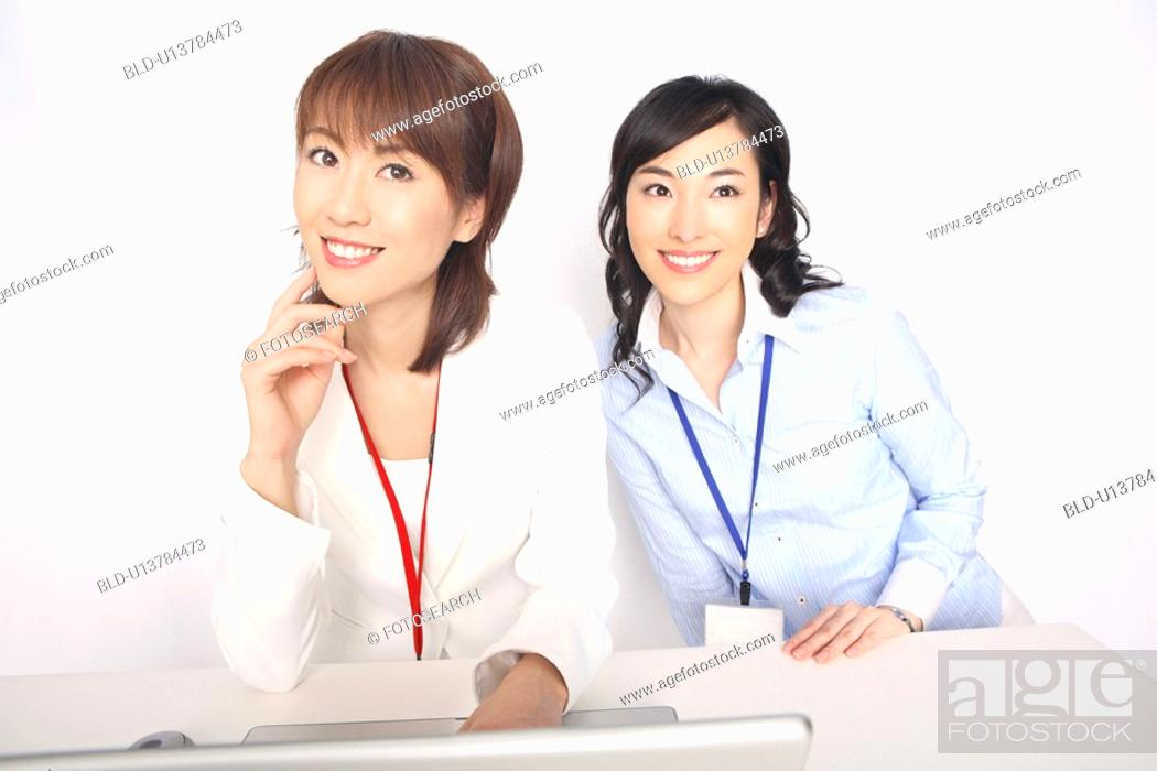 Stock Photo: Business lady and the fellow worker who sit down before a laptop computer.