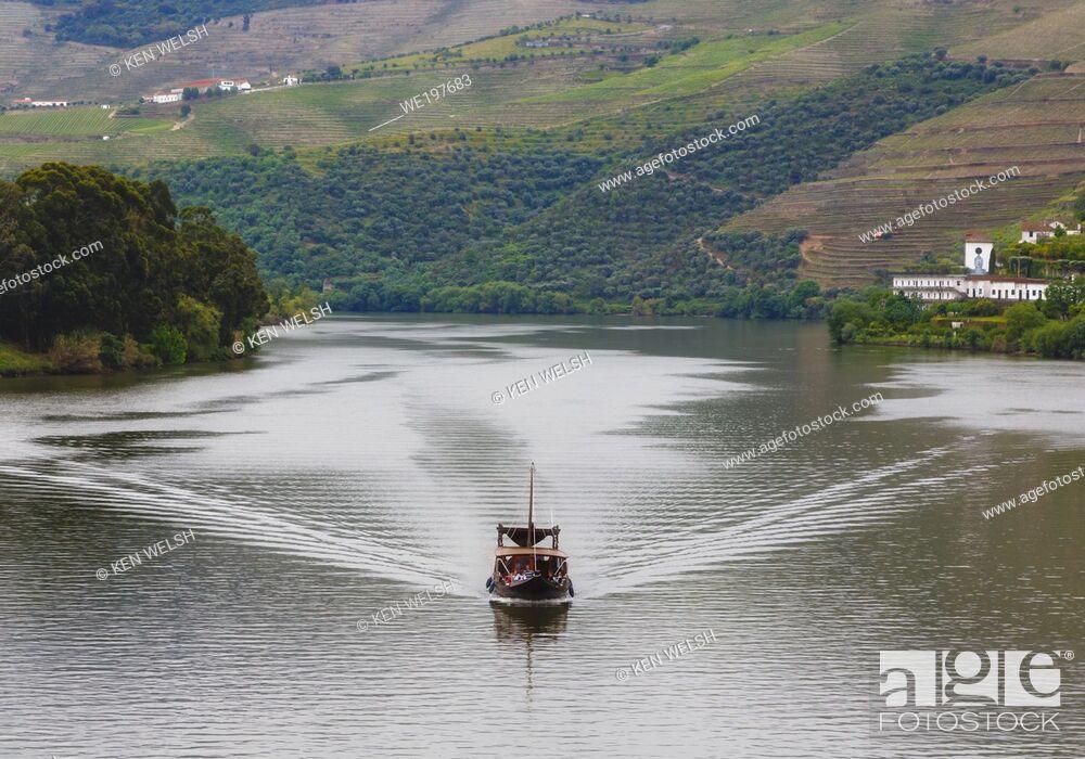 Stock Photo: Pleasure boat on the Douro River near Pinhao, Vila Real District, Portugal. The Alto Douro WIne Region is a UNESCO World Heritage Site.