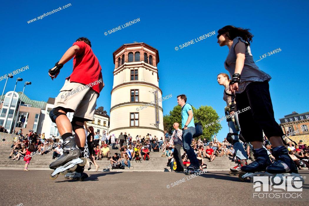 Stock Photo: Skater in front of Schlossturm, Old town, Duesseldorf, Duesseldorf, North Rhine-Westphalia, Germany, Europe.