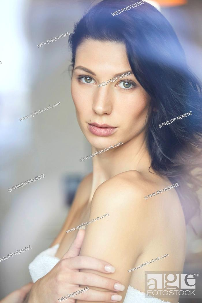 Stock Photo: Portrait of attractive dark-haired young woman.