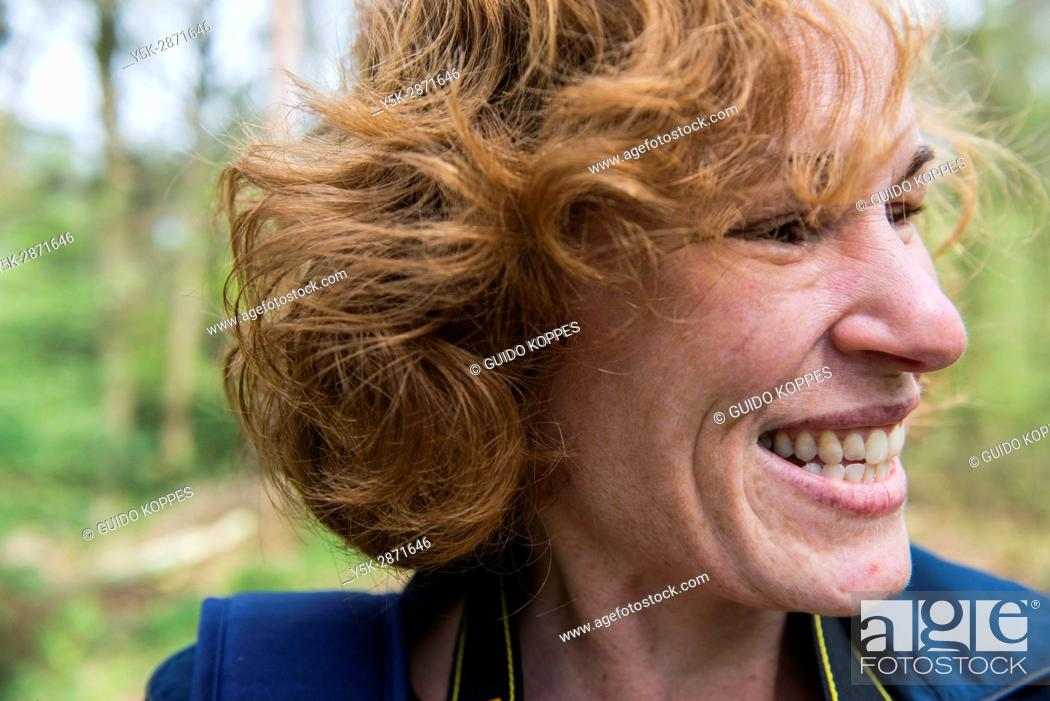 Stock Photo: Regte Heide, Riel, Netherlands. Red headed caucasian woman strolling a nature reserve park and forest on a free weekend afternoon.