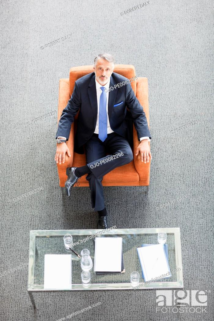 Stock Photo: Portrait of businessman sitting in armchair.