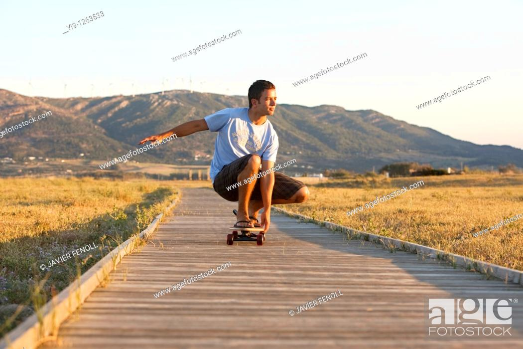 Stock Photo: Young male riding a skateboard.