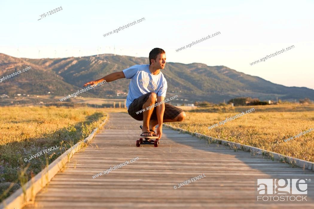 Photo de stock: Young male riding a skateboard.