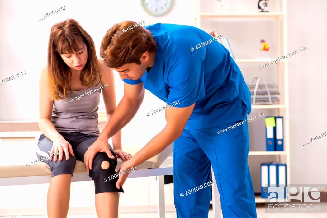 Stock Photo: Young female patient visiting male doctor traumatologist.