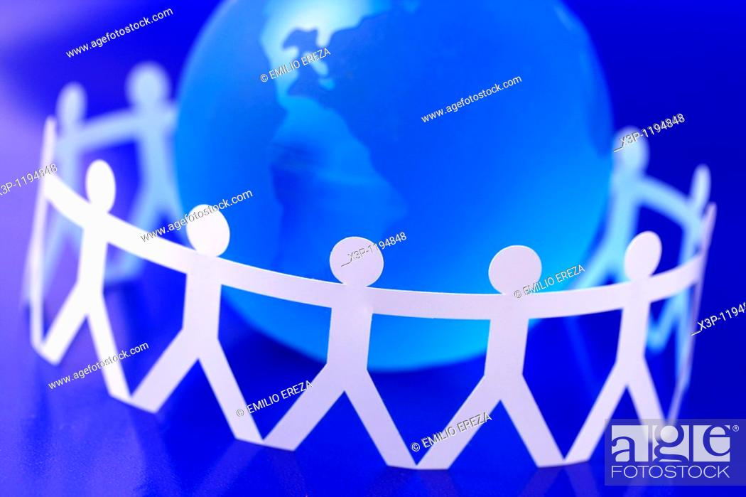 Stock Photo: Hand holding figures and earth.