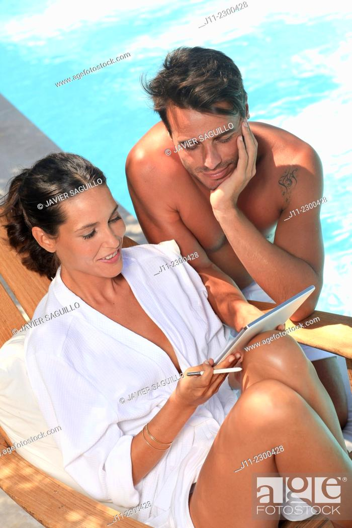 Stock Photo: Couple by the pool.
