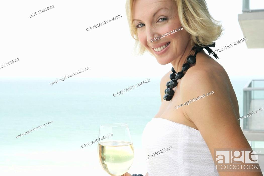 Stock Photo: View of a woman with a wineglass.