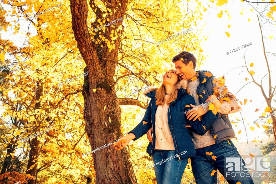 Stock Photo: Happy couple having fun in autumn in a forest.