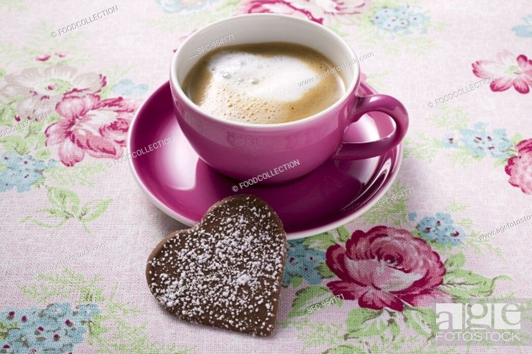 Stock Photo: Cup of cappuccino with chocolate heart.