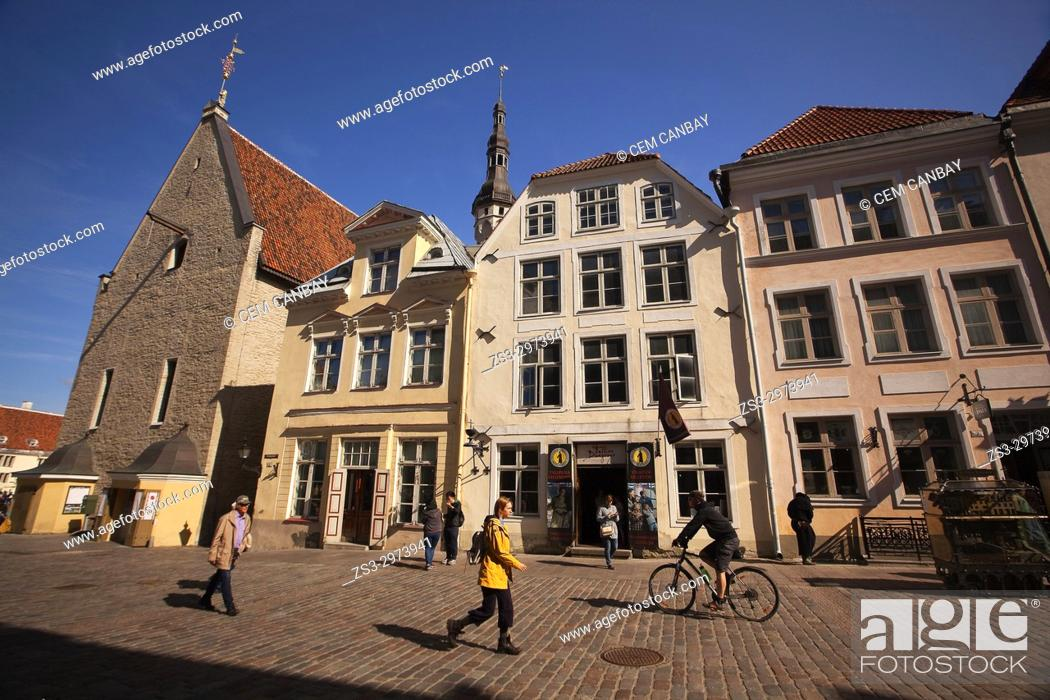 Stock Photo: People in front of the traditional buildings near the Town Hall in the old town, Tallinn, Estonia, Baltic States, Europe.