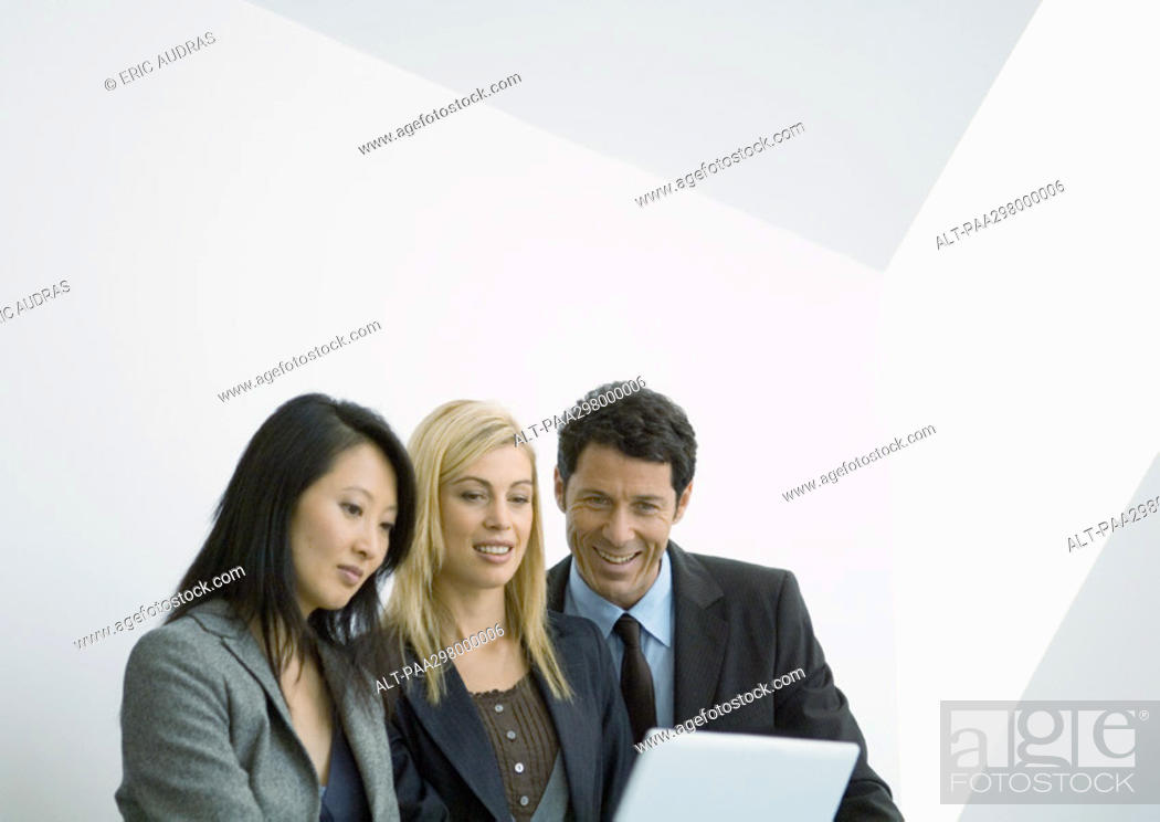 Stock Photo: Businesspeople looking at laptop.