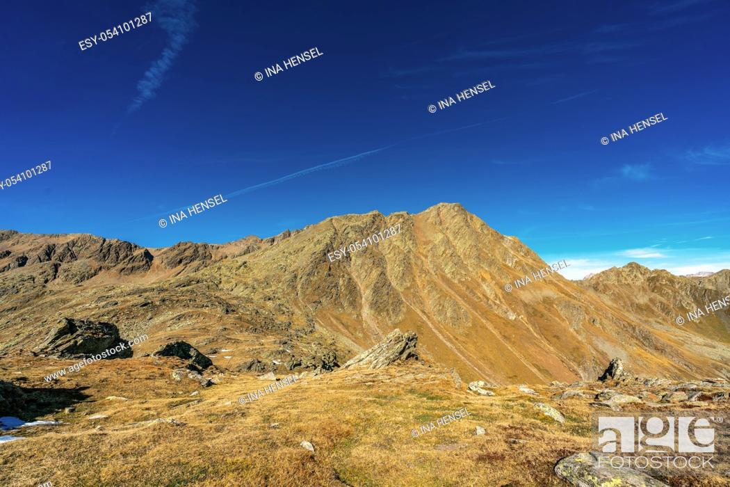 Stock Photo: Panoramic view of the Texel group mountains in the austrian/italian alps at the Timmelsjoch summit on a clear and sunny day in autumn 2019.
