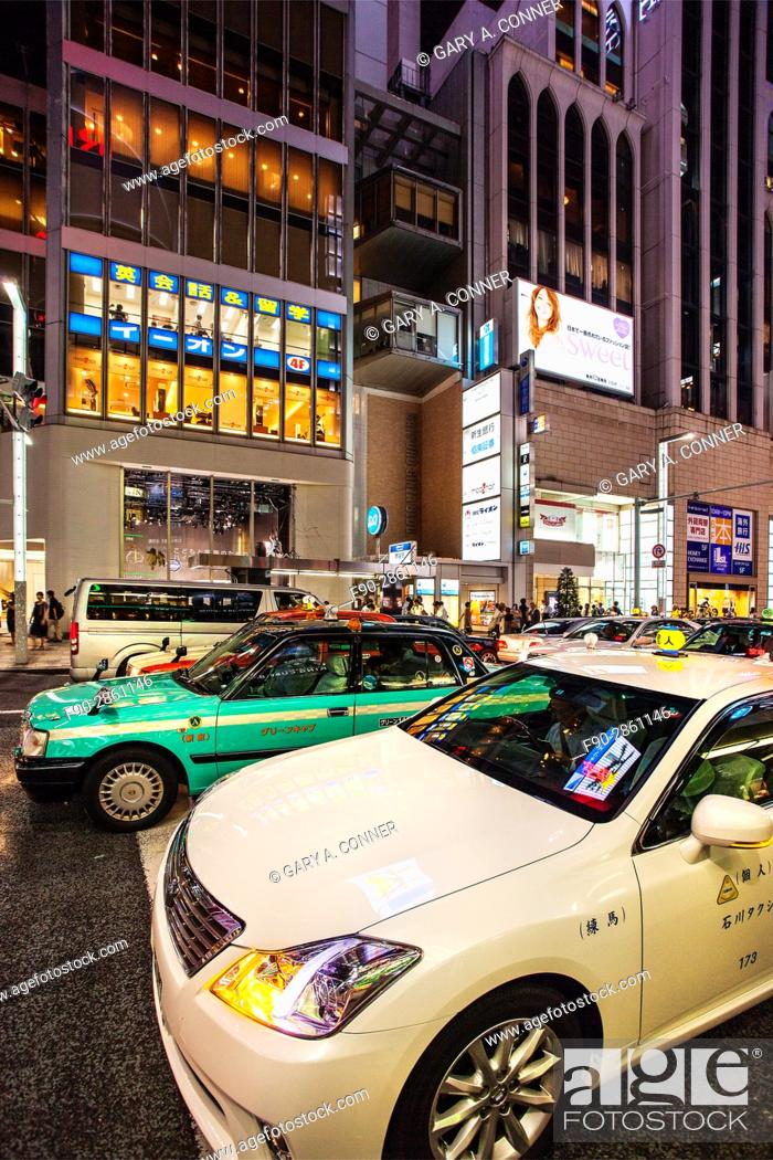 Stock Photo: Taxi traffic in the evening, Ginza, Tokyo, Japan.