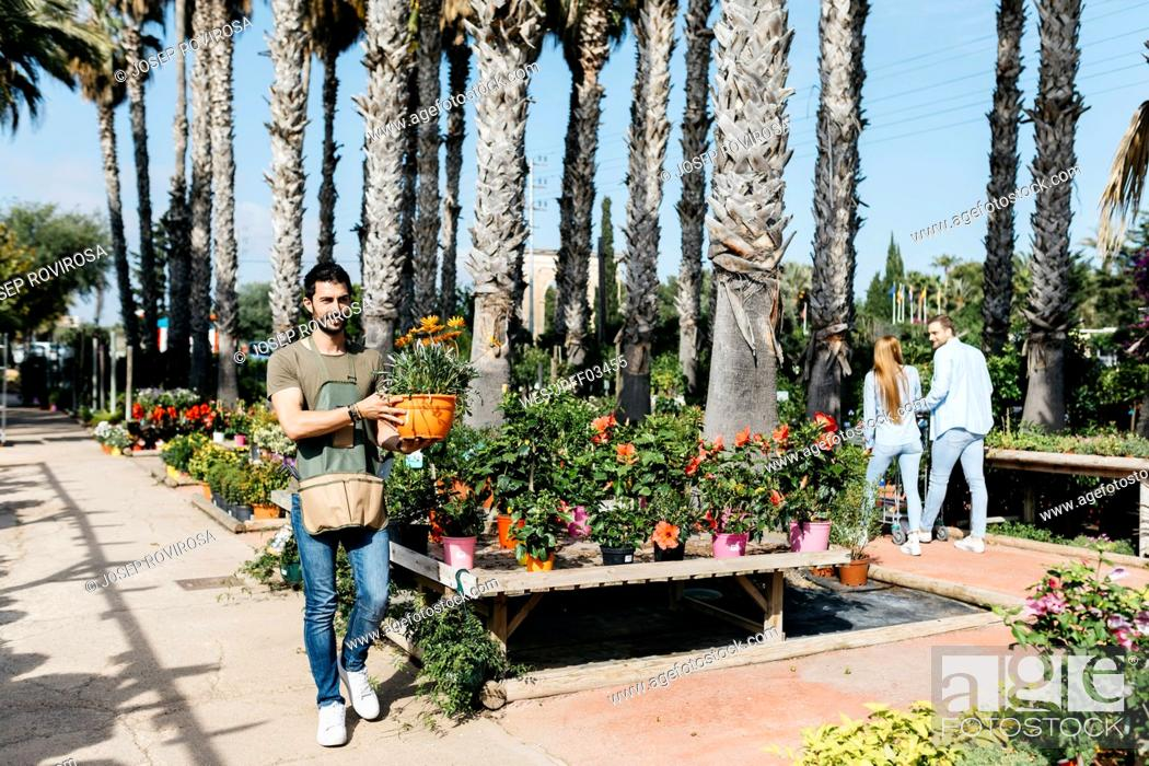 Stock Photo: Worker and customers in a garden center.