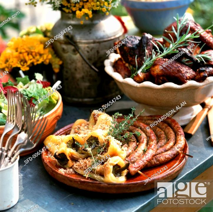 Stock Photo: Platter with Grilled Sausage and Peppers with Thyme, Barbecued Chicken with Rosemary and Salad.