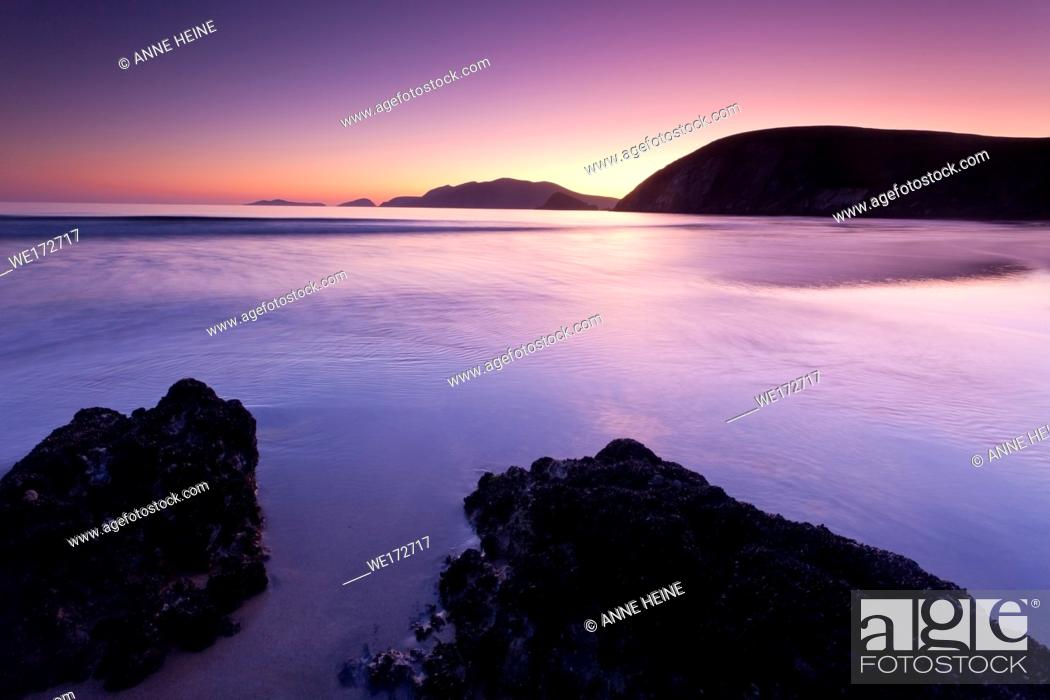 Stock Photo: Twilight colours on Coumeenoole beach at twilight looking towards Blasket Islands, which are the most westerly point of europe.