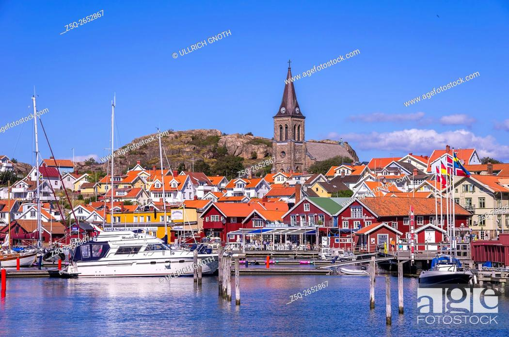 Stock Photo: Overlooking the waterfront and the church of the fishing village of Fjallbacka in Bohuslan county, Sweden, being famous by the crime stories of the Swedish.