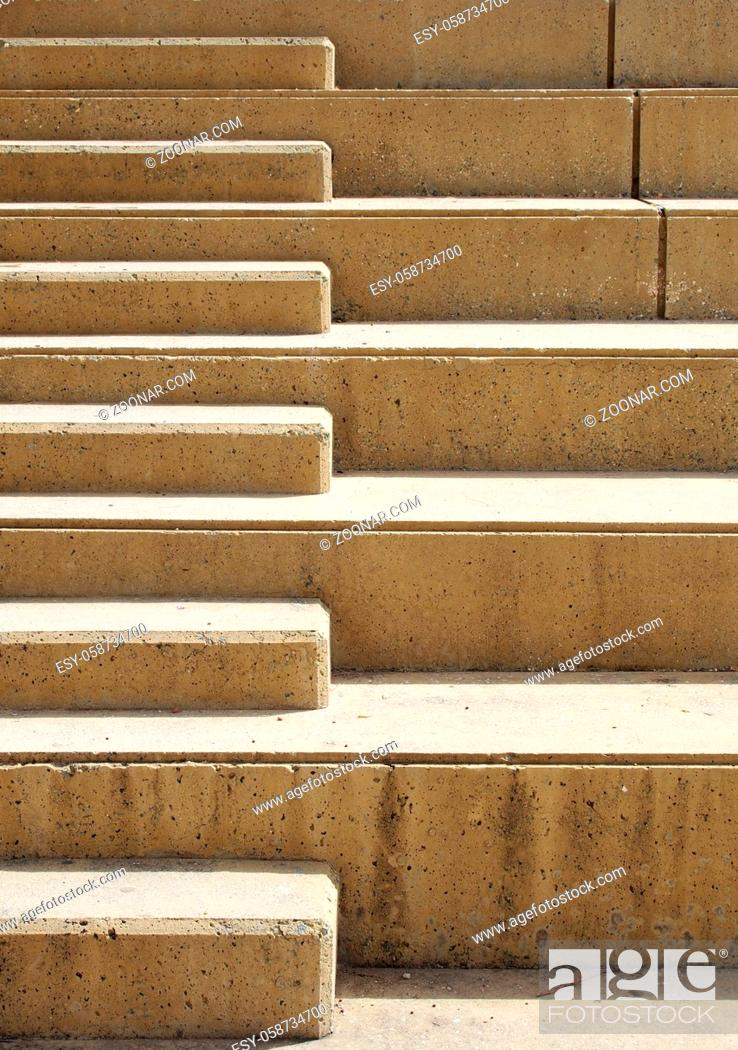 Stock Photo: close up of outdoor concrete stairway with geometric shapes in bright sunlight.