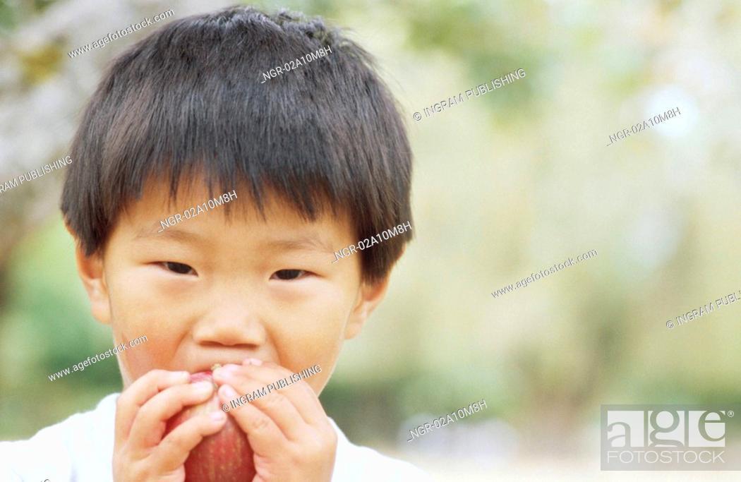 Stock Photo: Boy Eating Apple.