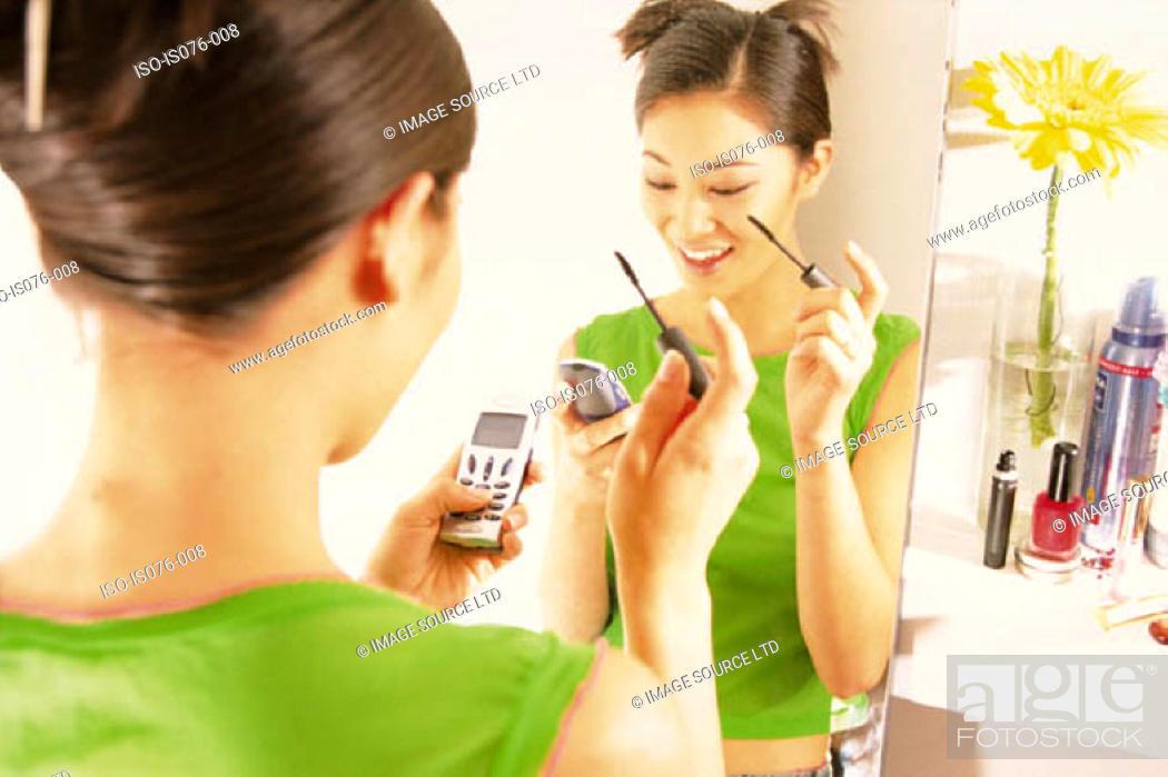 Stock Photo: Girl with mascara.