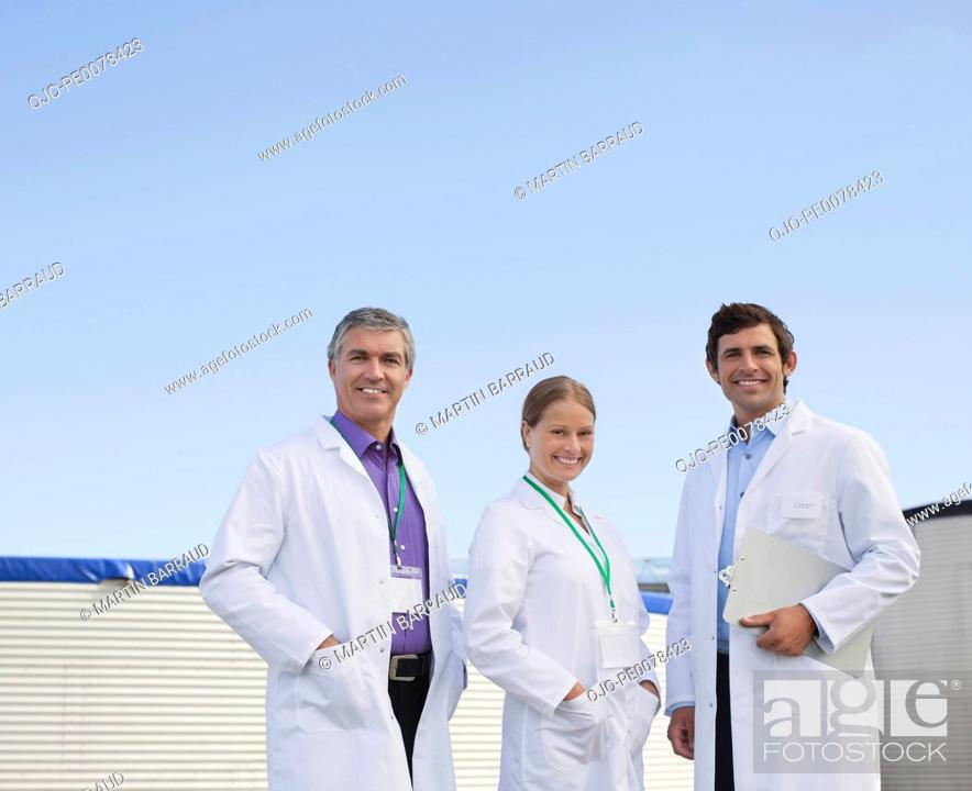 Stock Photo: Scientists standing together outdoors.