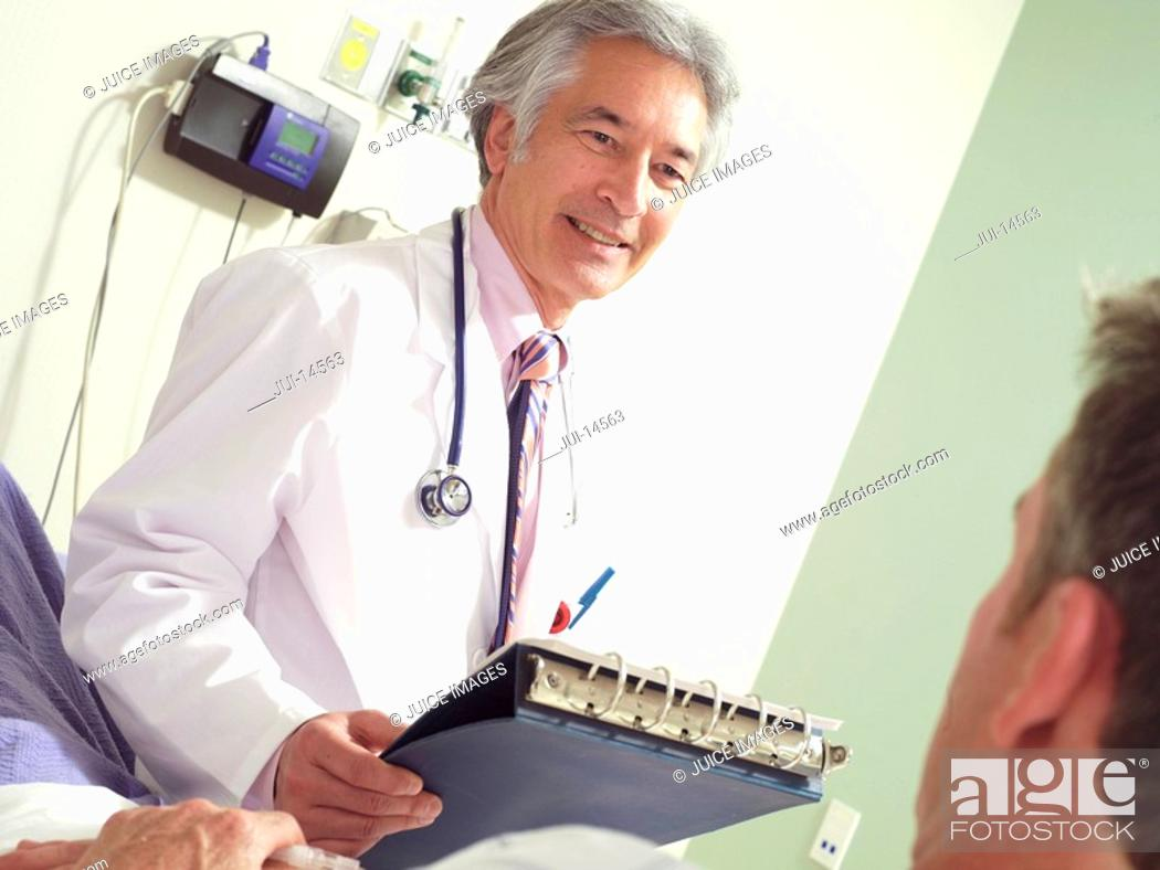 Stock Photo: Doctor with patient, smiling tilt.