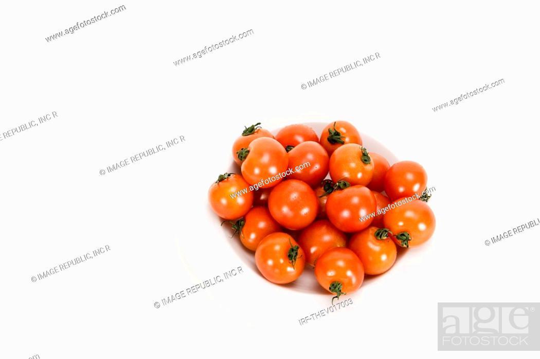 Stock Photo: cherry tomato on plate.