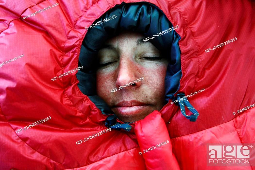Photo de stock: Woman in red sleeping bag.