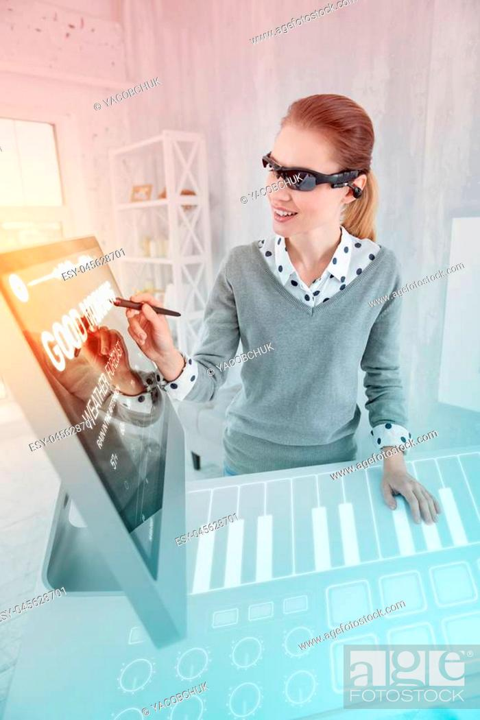 Stock Photo: Creative person. Clever experienced web designer smiling while wearing virtual reality glasses and holding a convenient stylus.